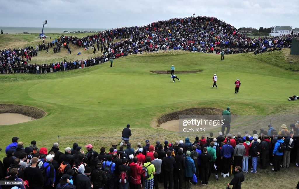 Northern Irish golfer Rory McIlroy (Centre R) and Spanish golfer Sergio Garcia (Centre L) are pictured on the 6th green on the final day of the 140th British Open Golf championship at Royal St George's in Sandwich, Kent, south east England, on July 17, 2011. AFP PHOTO / GLYN KIRK