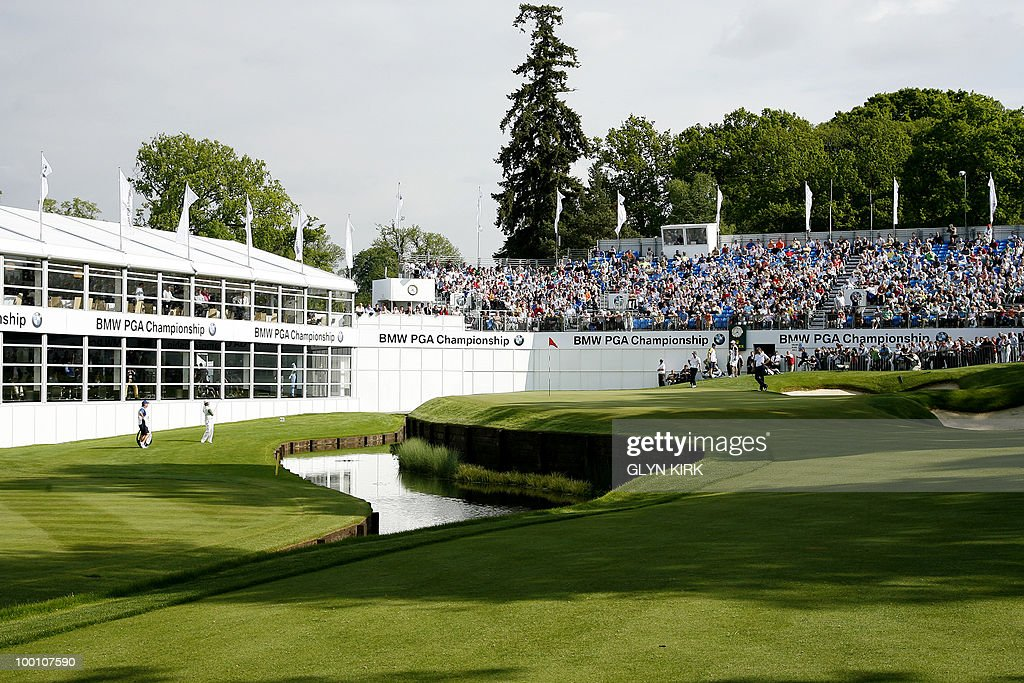 Northern Irish golfer Rory McIlroy (L) chips onto the remodeled 18th green during the first day of the PGA Championship on the West Course at Wentworth, on May 20, 2010.