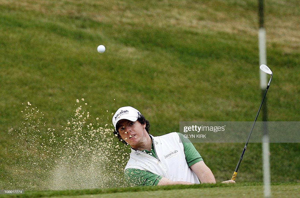 Northern Irish golfer Rory McIlroy plays out of a bunker at the 3rd green during the first day of the PGA Championship on the West Course at Wentworth, England, on May 20, 2010.