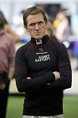 Northern Irish jockey AP McCoy attends the opening day of the Grand National Festival horse race meeting at Aintree Racecourse in Liverpool Northern...