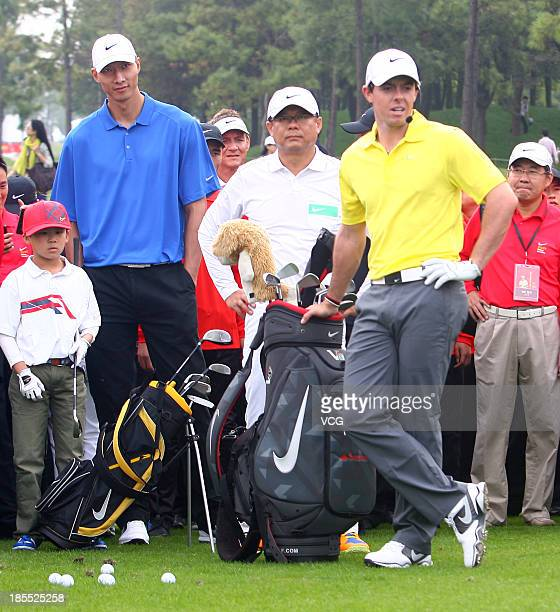 Northern Irish professional golfer Rory McIlroy and Chinese basketball player Yi Jianlian attend a Nike event ahead of the 2013 BMW Masters at Lake...