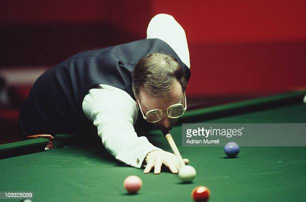 Northern Irish snooker player Dennis Taylor playing against defending world champion Steve Davis in the World Snooker Championship final at the...