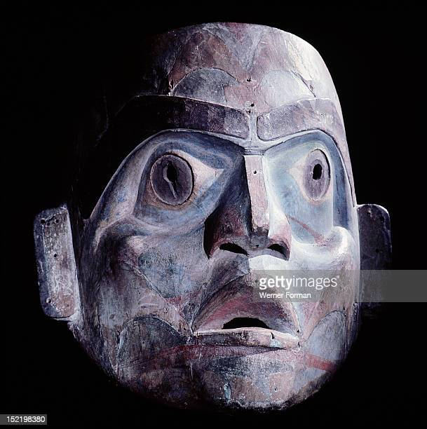 A northern Kwakiutl mask of a human like face One of various spirits which in performances of the Dluwulaxa masked dance lifted the dancers up to...