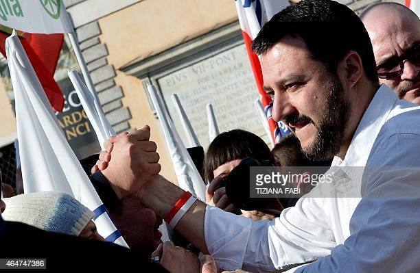 Northern League party leader Matteo Salvini shakes hands during a rally in Rome February 28 2015 The leader of Italy's rightwing Lega Nord party...