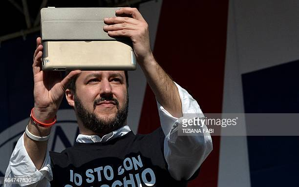 Northern League party leader Matteo Salvini takes pictures as he helds a rally in Rome February 28 2015 The leader of Italy's rightwing Lega Nord...