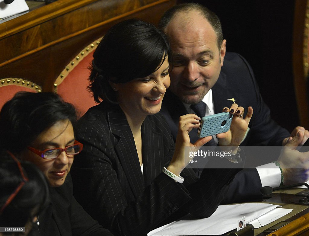 Northern League Patrizia Bisinella looks at her mobile phone during the first session of the senate on March 15, 2013 in Rome. General election in Italy took place on February 26 but as a majority in both chambers of parliament is required to form a government, Italy is left in a state of limbo with a hung parliament that is unprecedented in its post-war history.