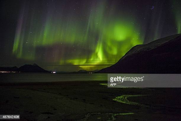 A Northern light is seen near Tromsoe Northern Norway on October 21 2014 AFP PHOTO / NTB scanpix/ JAN MORTEN BJOERNBAKK NORWAY OUT