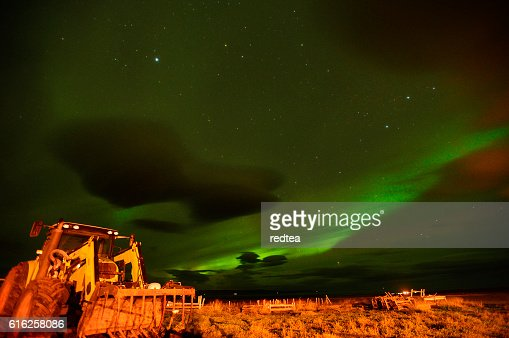 Northern light over a farm house in Iceland : Stock Photo
