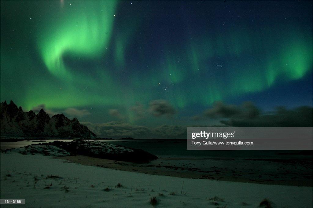 Northern light over mountain : Stock Photo