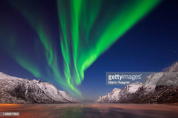 Northern lights (Aurora Borealis) at a fjord