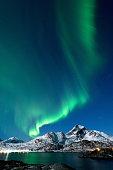 Northern lights brighten up the cold winter night in Lofoten Islands, Norway