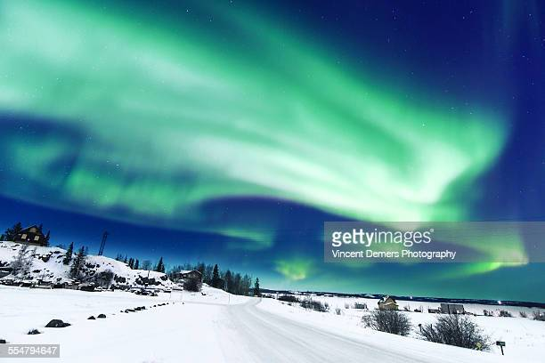 Northern Lights over a snow-covered road