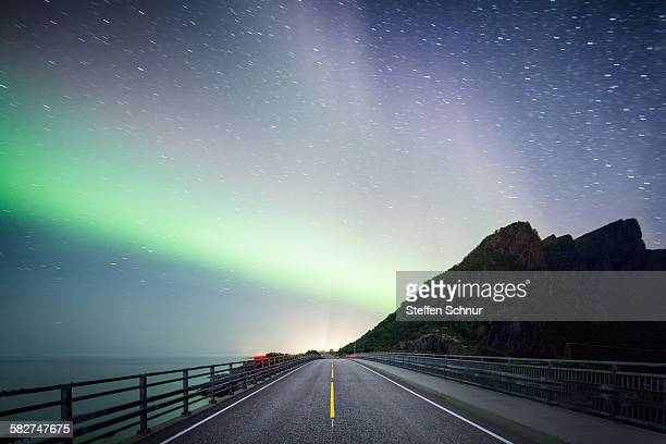 Northern lights over an empty street Norway