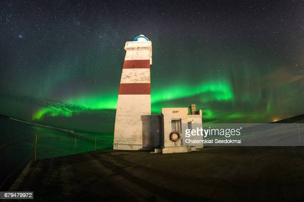 Northern lights (Aurora borealis) over lighthouse
