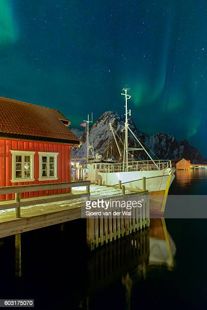 Northern lights over Svolvaer harbour in the Lofoten, Norway