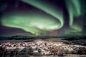 Aurora Borealis over a village in the north of Sweden.