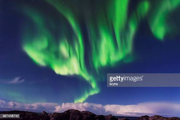 Northern lights with full moon near Svolvaer,Lofoten, Norway