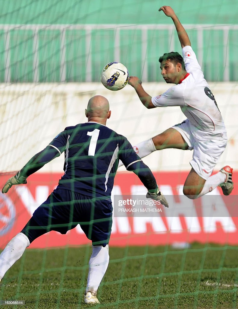 Northern Mariana Islands' goalkeeper Johann Thomas Noetzel (L) fails to stop the ball as Palestine player Alaa A.I. Atiya shoots to score during their AFC Challenge cup Qualification 2014 football match in Kathmandu on March 4, 2013. Palestine won the match 9-0. AFP PHOTO /Prakash MATHEMA