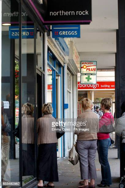 Northern Rock customers wait outside a branch in Nottingham