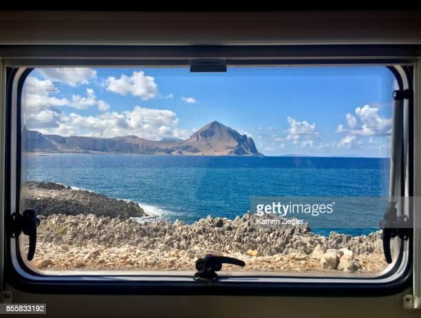 Northern Sicilian coastline seen through camper window