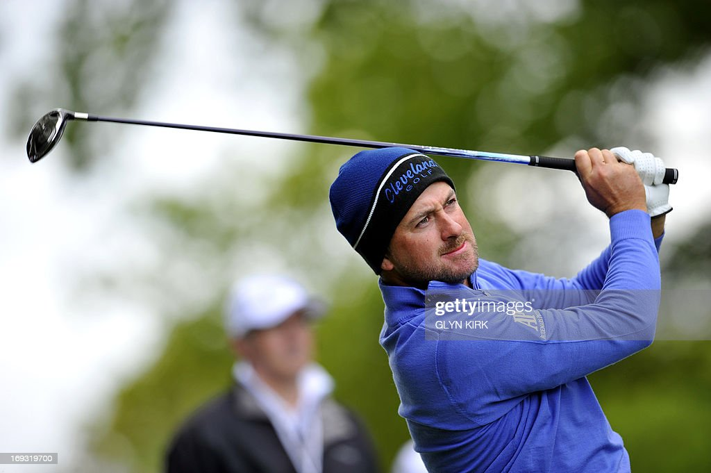 Northern-Irish golfer Graeme McDowell watches his approach shot from the 4th green during the first round of the PGA Championship at Wentworth Golf Club in Surrey on May 23, 2013.