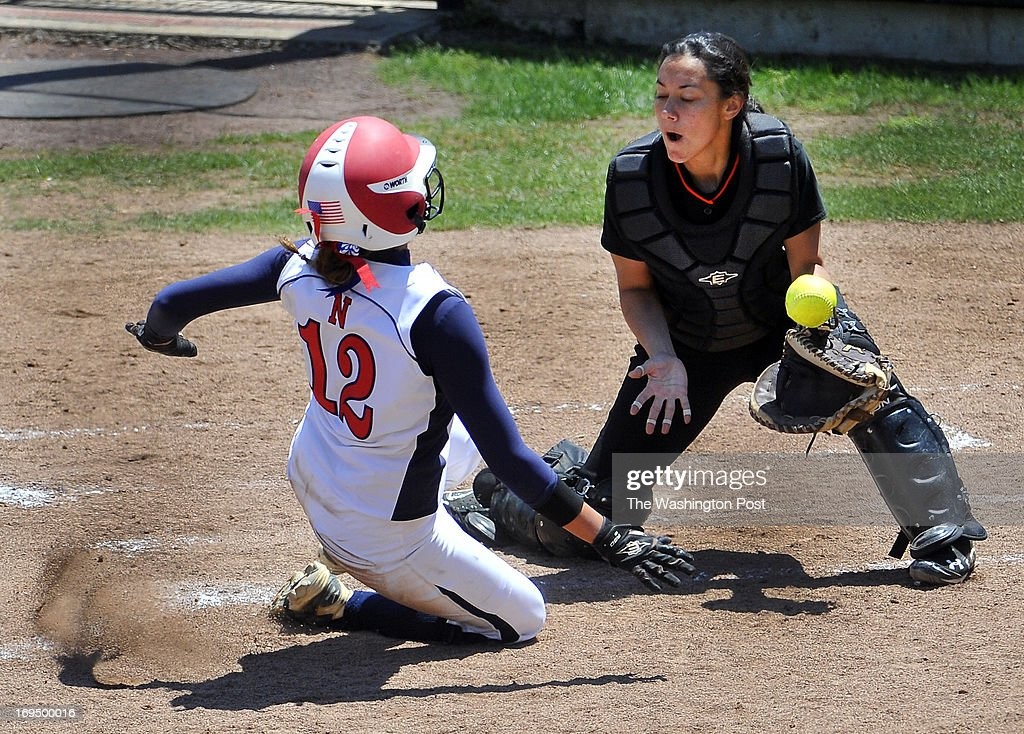 Northern's Julie Keleti scored as the ball skipped on the top of Eastern Tech catcher Brooke Samios-Uy in first inning of the Maryland 3A softball championship game at the University of Maryland's Robert E. Taylor Stadium on May, 25, 2013 in College Park, Md.