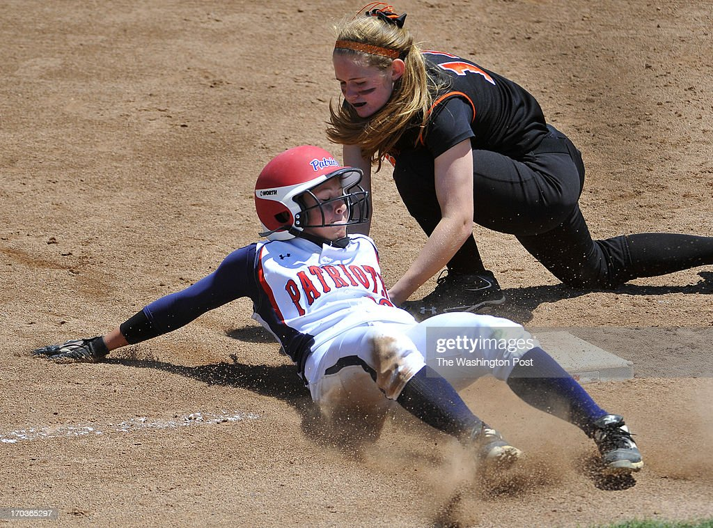 Northern's Julie Keleti slides safety into thrird base as the late tag of Eastern's Lindsay Meyers in the first inning of Maryland 3A softball championship game at the University of Maryland's Robert E. Taylor Stadium on May, 25, 2013 in College Park, Md.