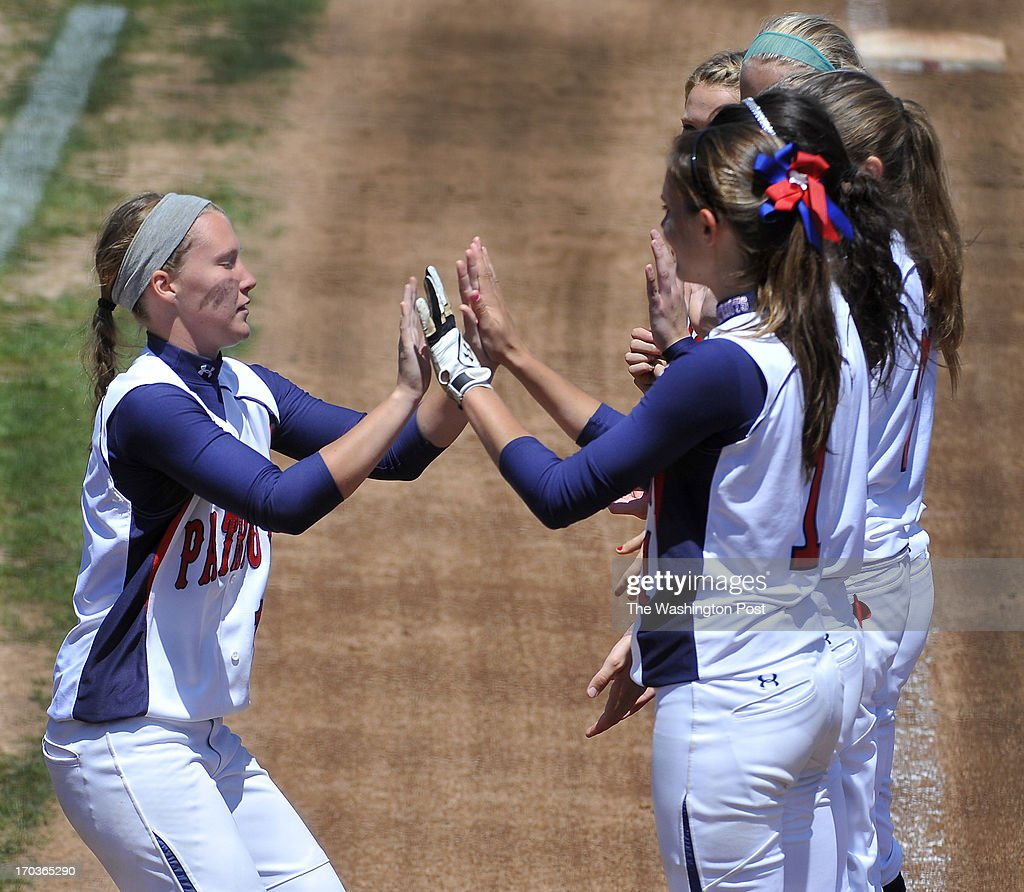 Northern's Kayla Grantham(L) high-fives teammates as she was introducted at the Maryland 3A softball championship game with Eastern Tech at the University of Maryland's Robert E. Taylor Stadium on May, 25, 2013 in College Park, Md.