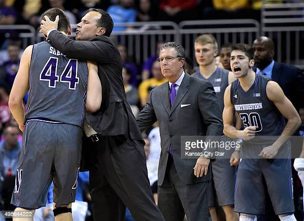 Northwestern coach Chris Collins congratulates Gavin Skelly as time runs out in a 6762 win against Missouri in the CBE Classic at the Sprint Center...