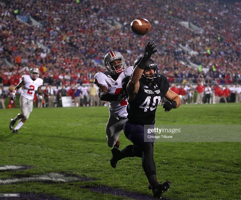 Northwestern fullback Dan Vitale (40) is unable to catch a ball in the end zone as Ohio State safety C.J. Barnett defends in the first quarter at Ryan Field in Evanston, Illinois, on Saturday, October 5, 2013.