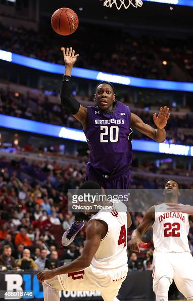 Northwestern guard/forward Scottie Lindsey runs over Indiana guard Robert Johnson during the first half of their firstround Big Ten Tournament game...