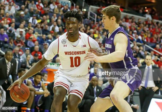 Northwestern Wildcats forward Gavin Skelly guards Wisconsin Badgers forward Nigel Hayes during a Big 10 tournament semifinal game between the...