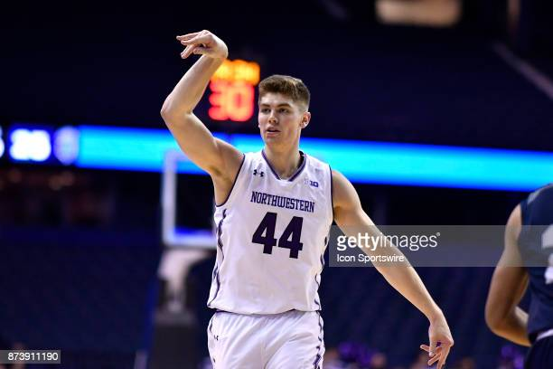 Northwestern Wildcats forward Gavin Skelly reacts after making a three point basket during a college basketball game between Northwestern Wildcats...