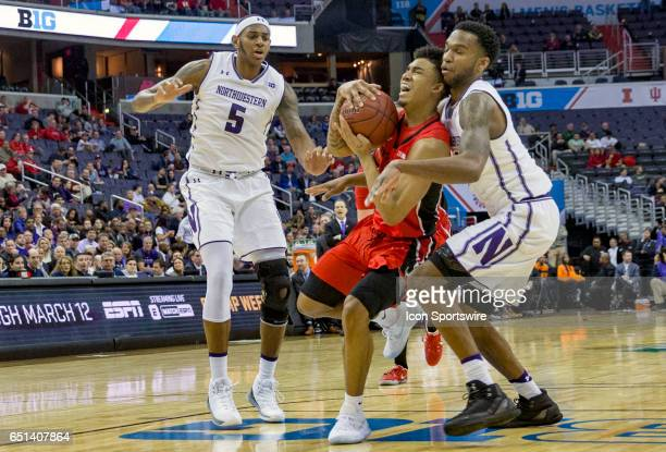Northwestern Wildcats forward Vic Law blocks Rutgers Scarlet Knights guard Corey Sanders during a Big 10 tournament secondround game between the...