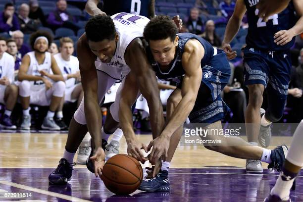 Northwestern Wildcats guard Anthony Gaines and St Peter's Peacocks guard Davauhnte Turner battle for a loose ball during a college basketball game...