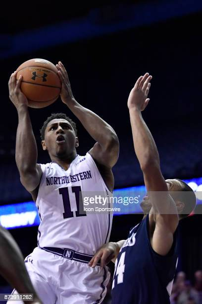 Northwestern Wildcats guard Anthony Gaines battles with St Peter's Peacocks guard Quinn Taylor during a college basketball game between Northwestern...