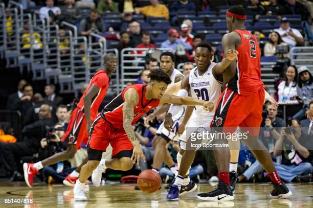 Northwestern Wildcats guard Scottie Lindsey tries to cut off Rutgers Scarlet Knights guard Corey Sanders during a Big 10 tournament secondround game...