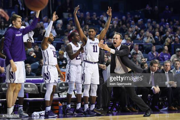 Northwestern Wildcats head coach Chris Collins signals for a timeout as guard Jordan Ash guard Anthony Gaines and guard Isiah Brown react during a...