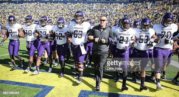 Northwestern Wildcats head coach Pat Fitzgerald walks with his team prior to the start of the game against the Michigan Wolverines on October 10 2015...