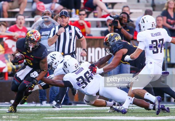 Northwestern Wildcats linebacker Blake Gallagher and running back Jesse Brown try to bring down Maryland Terrapins running back Ty Johnson during a...