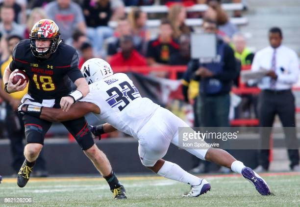 Northwestern Wildcats linebacker Nate Hall tackles Maryland Terrapins quarterback Max Bortenschlager during a college football game between the...