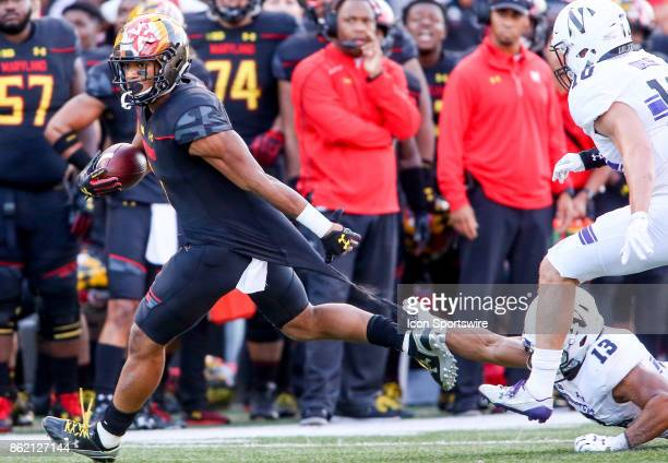Northwestern Wildcats linebacker Warren Long hangs onto the shirt tail of Maryland Terrapins wide receiver DJ Moore during a college football game...
