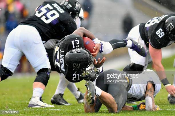 Northwestern Wildcats running back Justin Jackson is tackled by Minnesota Golden Gophers defensive back Jacob Huff during the game between the...