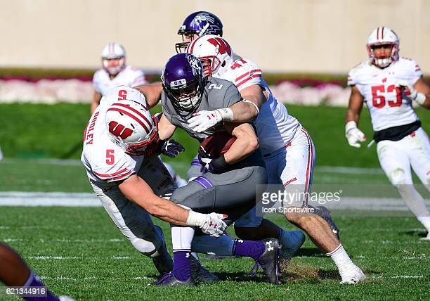 Northwestern Wildcats wide receiver Flynn Nagel gets tackled by Wisconsin Badgers linebacker Garret Dooley and Wisconsin Badgers linebacker Vince...