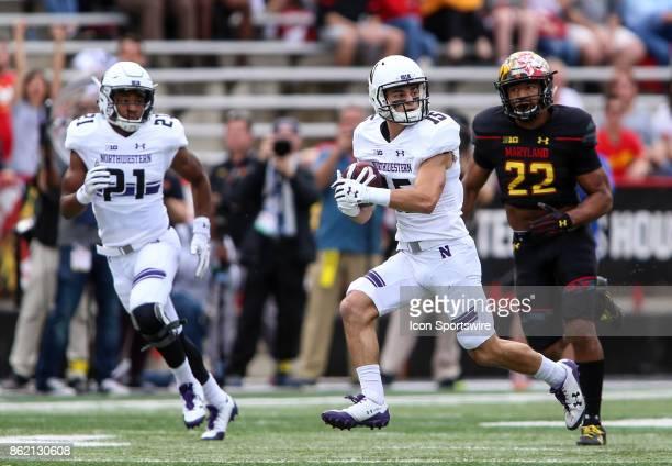 Northwestern Wildcats wide receiver Macan Wilson races away from Maryland Terrapins linebacker Isaiah Davis during a college football game between...