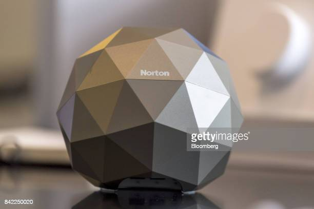 A Norton Core WIFI router stands on a table as Greg Clark chief executive officer of Symantec Corp speaks during an interview in San Francisco...