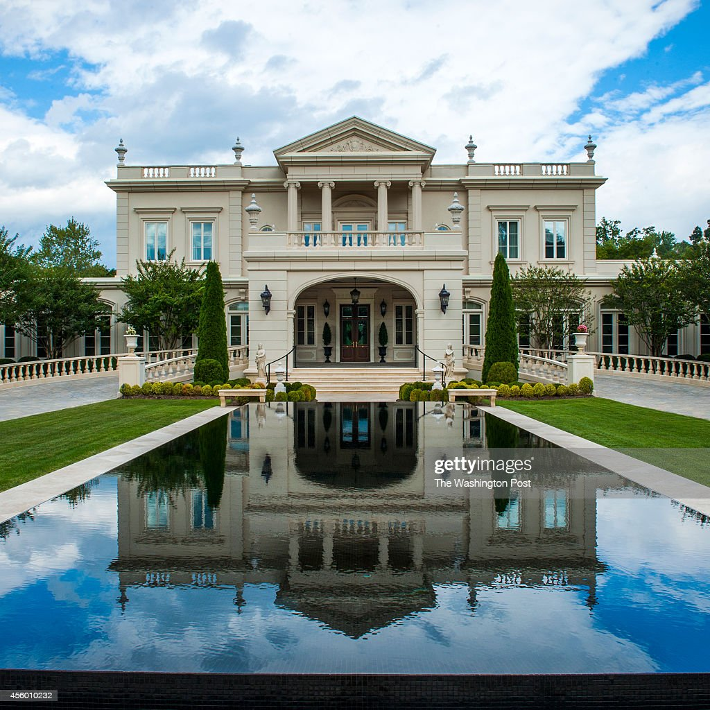 Norton Manor the 37000 square foot home of Frank Islam and his wife Debbie Dreisman is seen in a reflecting pool in front of their French Chateau...