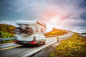 Caravan car travels on the highway. Caravan Car in motion blur. Norway. Atlantic Ocean Road or the Atlantic Road (Atlanterhavsveien) been awarded the title as 'Norwegian Construction of the Century'.