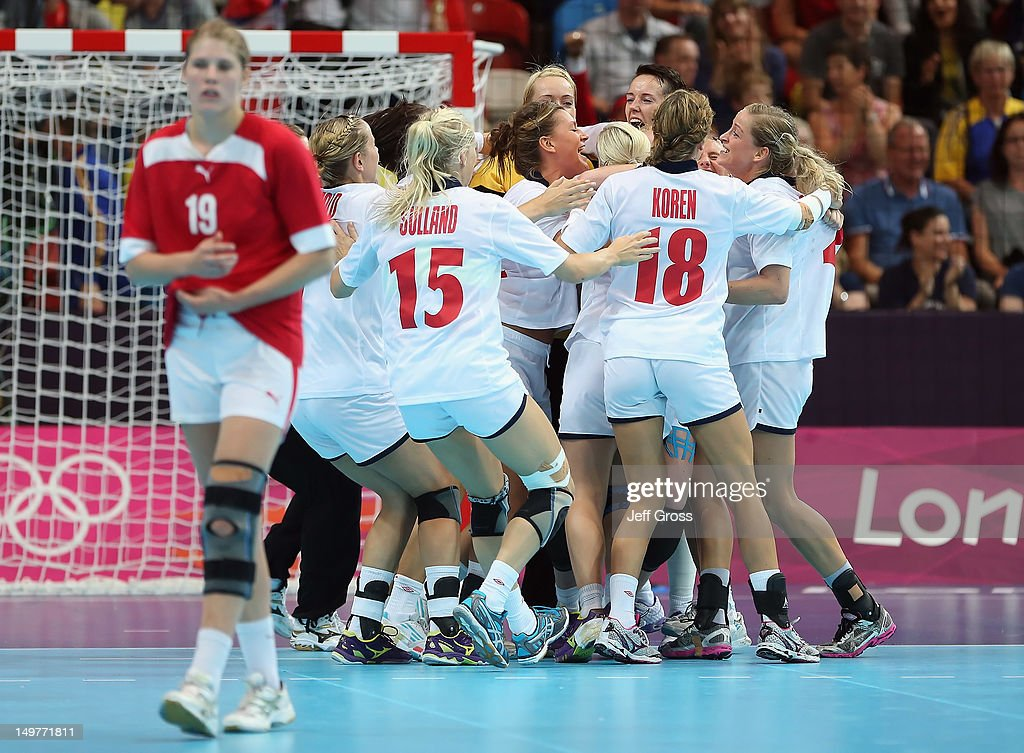 Norway celebrates their victory over Denmark during the Women's Handball Preliminaries Group A match between Norway and Denmark on Day 7 of the London 2012 Olympic Games at Copper Box on August 3, 2012 in London, England.