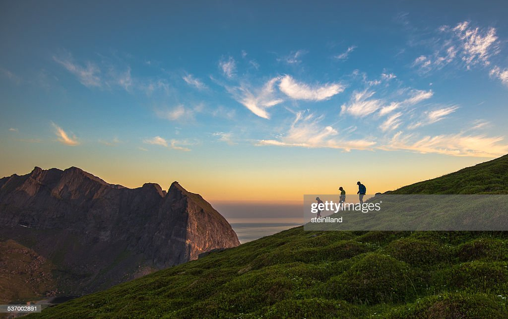 Norway, Flakstad Island, Tourist hiking on Mt Ryten